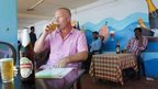 A British tourist drinks beer at a restaurant in Kerala, 9 September 2014