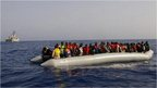 Migrants on a rescue lifeboat
