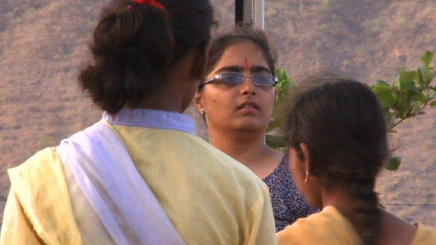 Prachi (facing camera) addresses a group of Durga Vahini girls
