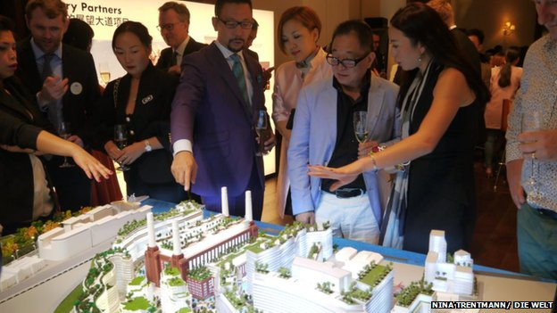 Prospective buyers in Shanghai eye a model of Battersea Power Station