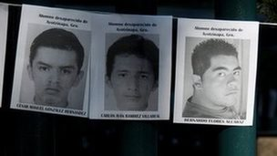 Images of the missing 43 rural college students hang on the front gate of the Mexican attorney general's office in Mexico City, Wednesday, Oct. 29, 2014.