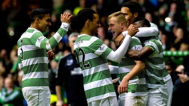 Celtic players celebrate as they defeat Partick Thistle 6-0
