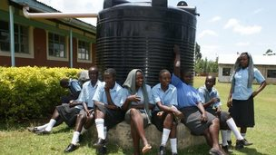Schoolgirls sit around a water tank in Laikipia county in northern Kenya