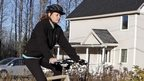 Nurse Kaci Hickox rides away from the home she is staying in on a rural road in Fort Kent, Maine, to take a bike ride 30 October 2014