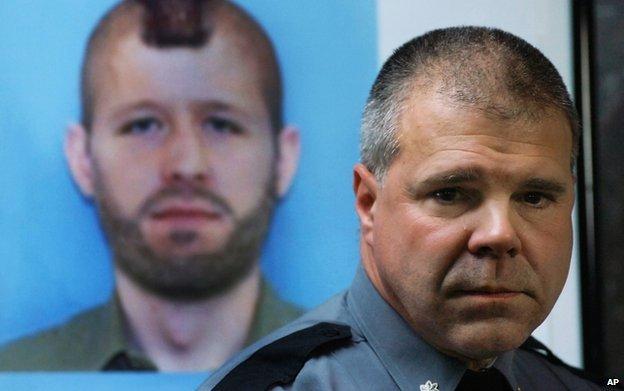 Pennsylvania State Police Lt. Col. George Bivens addresses the media