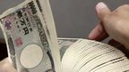 yen notes being counted