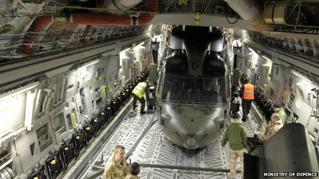 Merlin Helicopter from Royal Air Force Benson being loaded onto a C-17 Globemaster III military transport aircraft at RAF Brize Norton