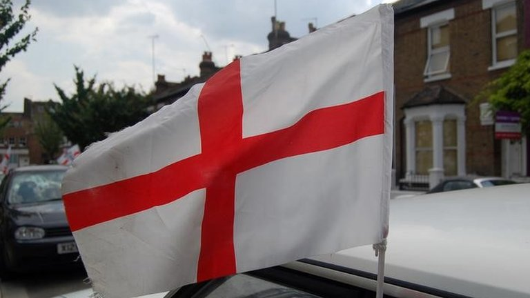 England flag flying from a car