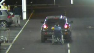 CCTV of car and wheelchair