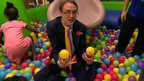 Reporter Chris Mason in ball pool