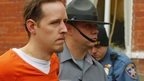 Eric Frein is escorted by police out the Pike County Courthouse after his arraignment in Milford, Pennsylvania 31 October 2014