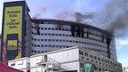 smoke rises from windows