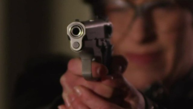 Joni Ernst holds a pistol in a campaign advert.