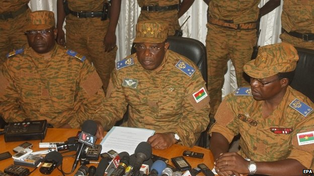 Army chief Gen Honore Traore (centre) holds media conference