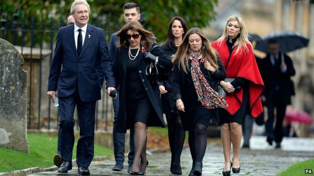 Jane McDonald (second left), Andrea McLean (third right) and Kate Thornton (right) join others mourners as they arrive for the funeral of Lynda Bellingham