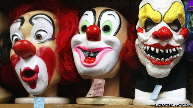 Clown masks displayed at a costume store