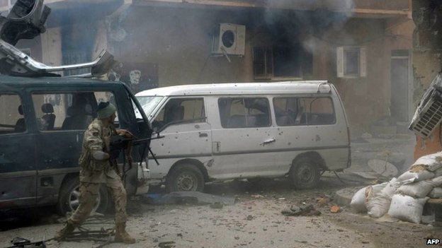 A member of the pro-government Libyan forces fires towards Islamist militiamen during clashes in the al-Salmani neighbourhood of the eastern coastal city of Benghazi, Libya, 2 November 2014