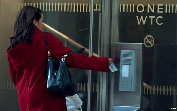 A woman enters the new building