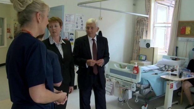 Peter Higson and Margaret Hanson talking to hospital staff
