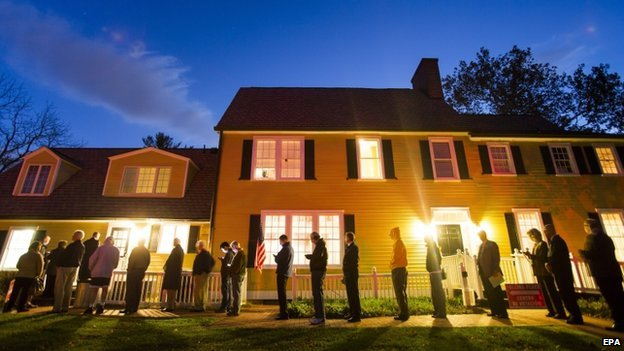Virginia residents wait in line in the pre-dawn hours to vote in the 2014 US midterm elections in Vienna, Virginia, USA, on 4 November 2014