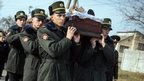 Ukrainian soldiers carry a coffin near Kiev (31 Oct)