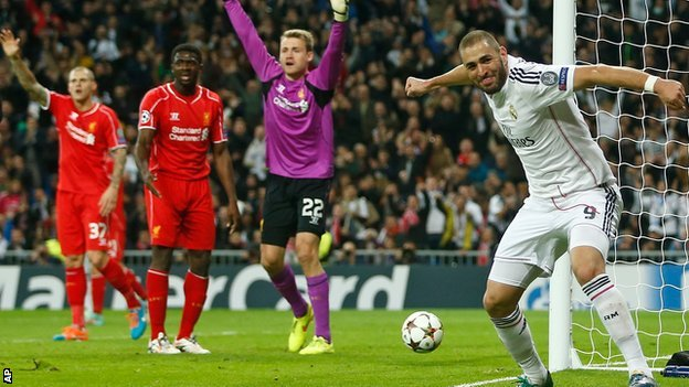 Karim Benzema scores Real Madrid's opener against Liverpool