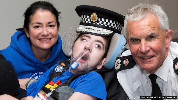 Dawn, Josh in police cap and Sir Peter Fahy