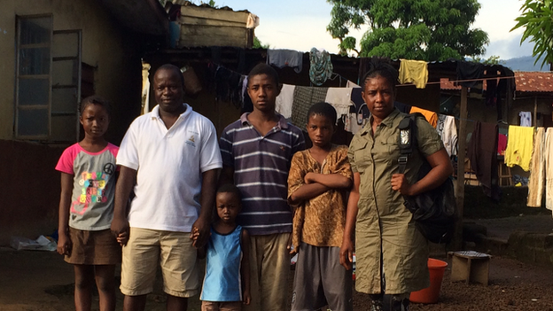 Mariatu Kagbo stands on the right of her husband and four of her children in Sierra Leone