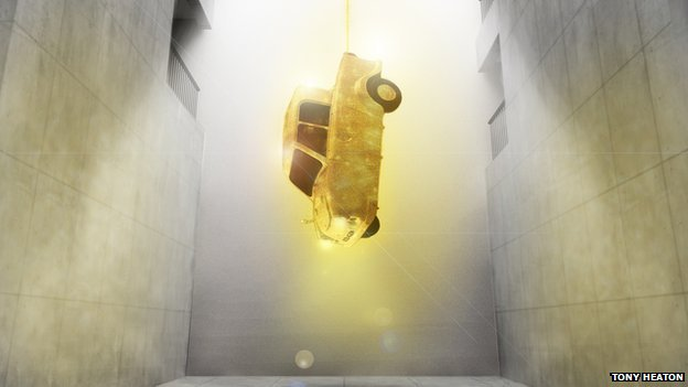 The Gold Lame Invacar hanging from the ceiling