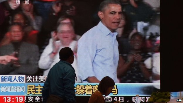 Screens in Beijing showing pictures of President Obama during the US mid-terms
