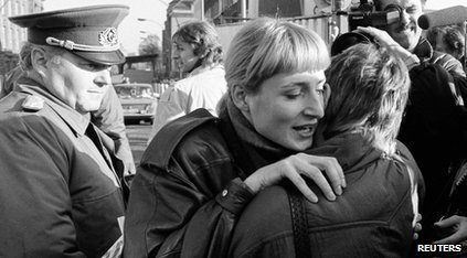 People embracing after Berlin Wall falls