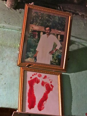 Portrait and footprints of Sunil Mandal, Gita's late husband