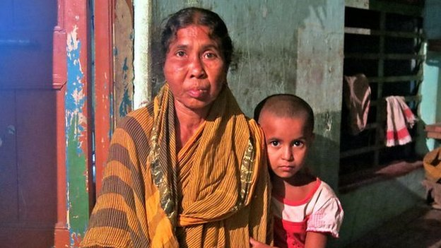 Gita Mandal, 55, with one of her four grand-daughters