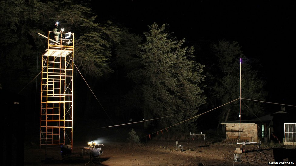 Foraging bats were attracted to this field location with the ultraviolet light tower seen in the right of the image, and the bat sounds were recorded on two microphone arrays placed below the light