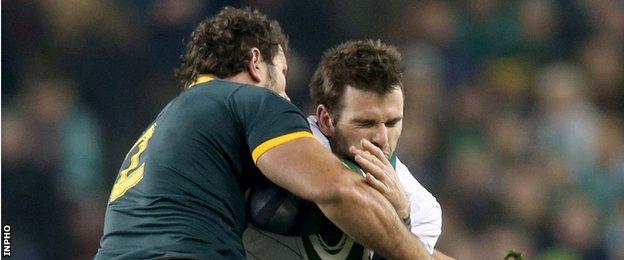 Jared Payne is tackled by Bismarck du Plessis