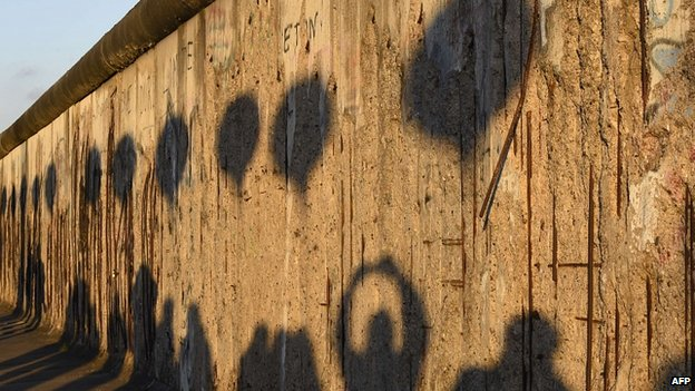 Shadows of people taking photos of the Berlin Wall. 8 Nov 2014