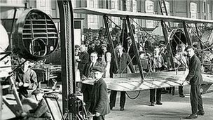 Men in aeroplane factory