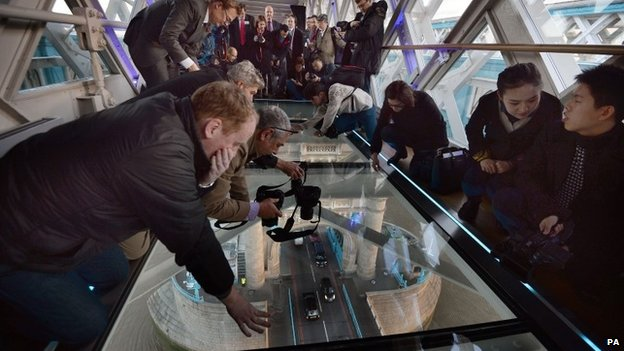 Visitors try out the new glass walkway at Tower Bridge
