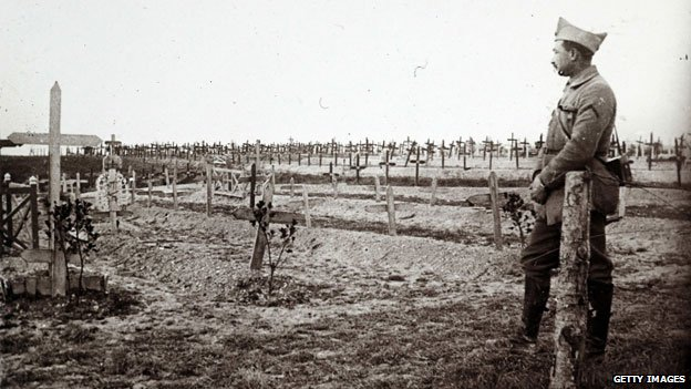 A French soldier looking at graves