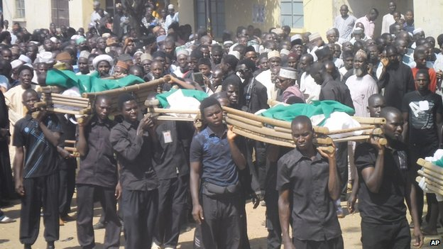 Bodies of the victims of a suicide bomb explosion are carried for burial in Potiskum, Nigeria on 4 November 2014