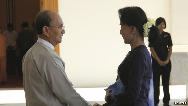 "Myanmar opposition leader Aung San Suu Kyi shakes hands with Myanmar""s President Thein Sein at the presidential palace in Naypidaw"