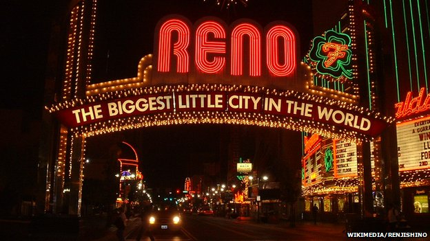 "An illuminated sign reading ""Reno: The biggest little city in the world"""
