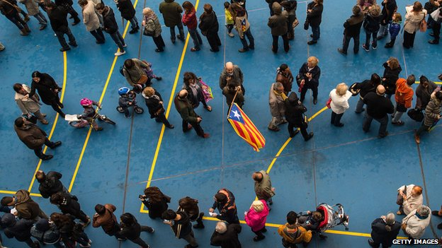 People wait for their turn to cast their vote at a polling station on November 9, 2014 in Barcelona, Spain. Catalans vote today during an unofficial and non-binding consultation on independence of Catalonia from Spain.