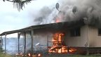 Close up of burning house in Pahoa (set alight by lava)
