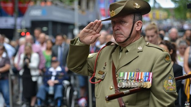 Australian Army Warrant Officer Stephen Chiesa observes a minute's silence at the Cenotaph national war memorial to pay tribute to the Commonwealth war dead on Armistice Day in Sydney on 11 November  2014