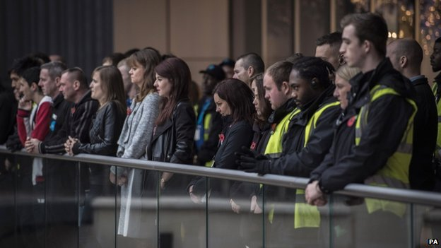 Staff and shoppers at a shopping centre in Bristol during the two minute silence.