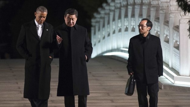 US President Barack Obama (left), Chinese President Xi Jinping (centre) and translator (right) in Beijing, 11 November 2014