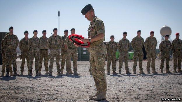 Brigadier Rob Thomson laying a wreath during an Armistice Day ceremony at Kandahar airfield, Afghanistan.