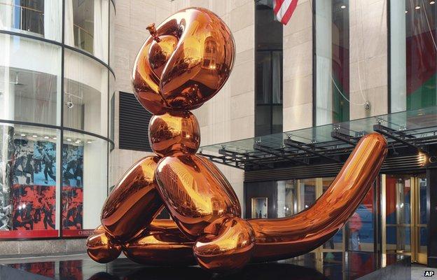 Balloon Monkey (Orange) by Jeff Koons