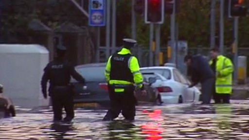 Police go the aid of a motorist in Newry